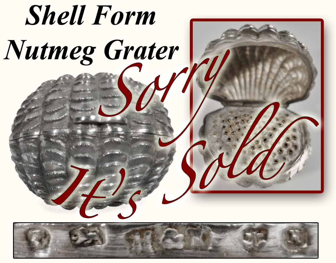 Shell Form silver nutmeg grater